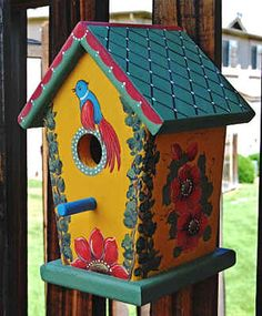 colorful painted birdhouses -