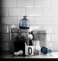 White beveled subway tile with oyster grey grout