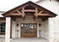 Grand entrance to a timber frame home #timberframe  www.texastimberframes.com https://www.facebook.com/TexasTimberFrames