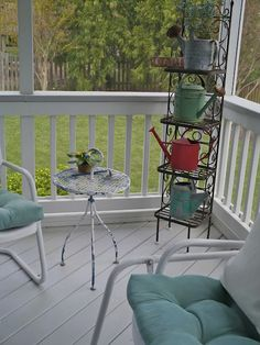 Porch décor - my very wordie this is exactly what I'm going to do with a plant stand I have near the front door - love the look - now just have to hunt out some gorgeous old watering cans!