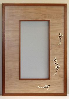 Matthew Werner Fine Furniture - Custom western maple mirror framed with mahogany.  Koi inlays with Holly & Yew... finished in Osmo Polyx oil & Wax