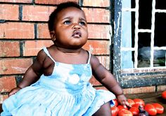 Little baby girl in Busia, a town on the border of Kenya and Uganda.