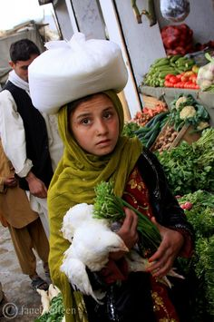 At the market in Asadabad, Kunar Province, Afghanistan. Asadabad or Asad Abad is the capital city of Kunar Province. It is located in the eastern portion of the country adjacent to Pakistan. (V)