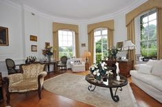 The ground-floor apartment's drawing room (pictured) was once Eden's ballroom and includes a corniced ceiling, a fireplace and window bay