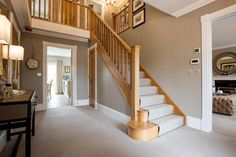 First impressions are everything. The hallway in our Highgrove show home will ta… First impressions are everything. The hallway in our Highgrove show home will take your breath away. Large, open but equally warm and welcoming House, Home, Detached House, Hallway Flooring, Show Home, House Staircase, Large Hallway, Cottage Hallway, Bungalow Renovation