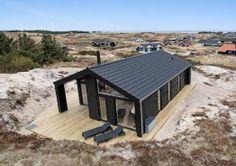 Schönes und strandnahes Ferienhaus mit überdachter Terrasse (Bild 1)