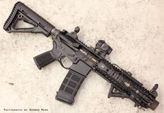 Spikes Tactical SBR with Spikes free float handguard, Magpul AFG2 flaming pig muzzle, Magpul CTR stock, Magpul MOE grip, PMag with grip tape and AimPoint micro.