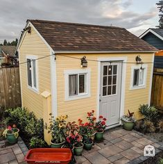 What makes a perfect She Shed? We think that lots of windows, plenty of plants, and some cozy cafe lighting go a long way to creating an incredible She Shed. Design a beautiful backyard retreat, starting with a new She Shed. This cozy yellow She Shed is surrounded by incredible landscaping, including a paver patio and a bright container garden collection. A new shed can be the start of a backyard paradise, especially when it's a Tuff Shed building. DIY your way to an incredible backyard.