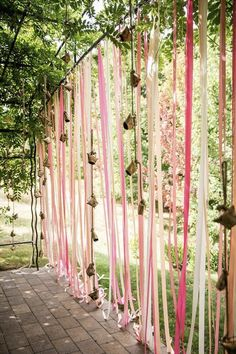 Use blush colored streamers with accents of your choice to line a pathway or create a backdrop at your outdoor boho wedding venue