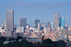 Johannesburg, nicknamed as 'Jozi' or 'Joburg' is one of the largest cities in South Africa and is a key tourist destination around the world. Johannesburg Skyline, Cities In Africa, Panorama City, Great Places, San Francisco Skyline, South Africa, Places To Visit, Around The Worlds, Landscape