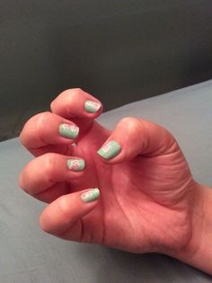 Mint green with rose nail tattoos.
