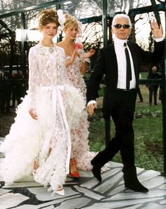 Karl Lagerfeld famously ended his Chanel couture fashion shows by presenting an over-the-top wedding look on one of his model uses. See all the A-list stars the late designer has walked down the ai… White Wedding Suit, Wedding Suits, Wedding Dresses, Lace Wedding, Formal Dresses, Couture Mode, Couture Fashion, Fashion Show, London Fashion