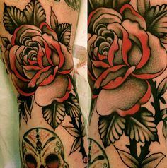 Awesome use of Colors.   Beautiful red and black rose tattoo by Stizzo