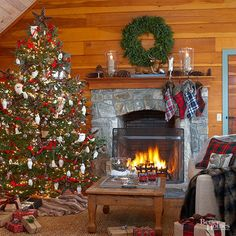 Strong red plaids and natural greens combine with woodsy elements to create a cozy cabin look. Faux fur blankets and a roaring fire make the room warm and inviting./