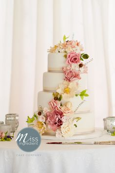 Wedding Cake with a cascade of handmade sugar flowers including roses and peonies by Miss Ingredient