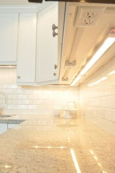 Outlets hidden under the cabinets so they don't interrupt the backsplash design - easier tile install. Genious!