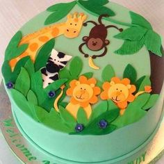 Jungle Baby Shower Cake by springlakecake. Love the idea of scrapbooking stickers on the cake round. Jungle Theme Cakes, Safari Cakes, Jungle Party, Safari Theme, Baby Cakes, Cupcake Cakes, 3d Cakes, Diaper Cakes, Lion Cakes
