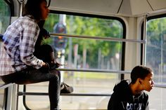 CHILDREN ARE THE FUTURE  Teens on tram 16.