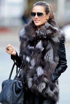 I normally don't care much for fur vests (faux or otherwise) but this one is so cute!