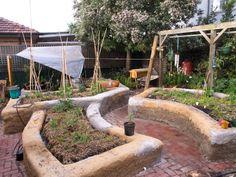 Raised earthbag garden beds with scratch coat of render