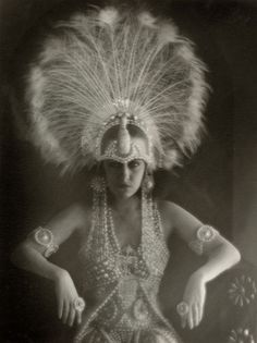 Gloria Swanson wearing a white peacock head dress in Male and Female (1919)