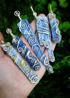 These wire wrapped blue kyanite crystals are so elegant! Definitely long enough to also be used as wearable wands. Raw Crystal Jewelry, Crystal Pendant, Rock Jewelry, Jewlery, Throat Chakra Healing, Wire Wrapping Crystals, Wire Crafts, Menorah, Bending