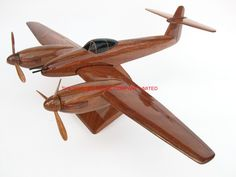"A beautiful hand carved desktop model of the Westland Whirlwind. The model has been carved from solid mahogany. The model comes boxed and is simple to assemble. The wings, tail fins, stand and rotas simply slot into pre-drilled holes on the body of the aircraft. No glue required. Size H 7"", L 14"", W 19"". Visit our website at http://www.thewoodenmodelcompany.co.uk to view the full range of our models."