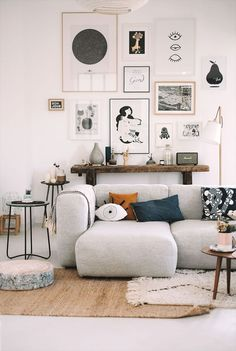 Lovely composition and it looks to inviting. Also love the art wall. #livingroomideas #livingroomfurniture #livingroompillows #livingroomdecor #livingroominspiration