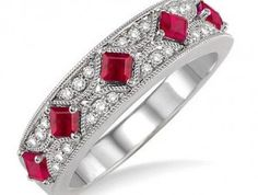 Dazzle her with the brilliance of this glowing princess cut ruby and diamond fashion band crafted on lustrous 14 karat white gold. This lovely milgrain band showcases 5 princess cut ruby enhanced by rows of gorgeous 24 round cut diamonds, beautifully prong and pave set. Total diamond weight is 1/6 ctw and princess cut ruby measures 2.5mm.