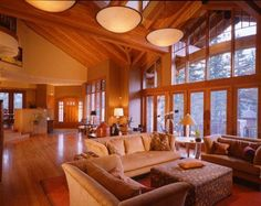 I'm really loving the soaring timber-lined ceilings and that awesome picture window!