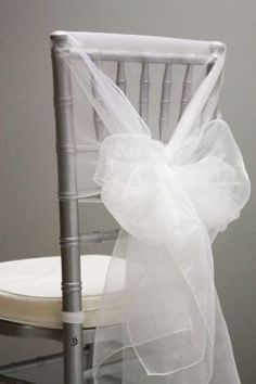 Snow Organza Chair Caps/Hoods - White Gift wrapping your chair covers .    Make your guests feel very important. Attention to detail with no effort.