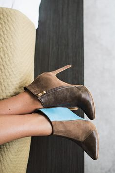 City meets country in these gorgeously versatile booties that feature a stiletto heel and contrast stripe. Wear them with jeans or your favorite skirt; you can't go wrong either way. 3 inch heel. Booties fit true to size.