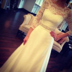 A-line skirt with lace overlay on the top, 3/4 sleeves with a sweet heart neckline under the lace. Beaded belt. GORGEOUS!