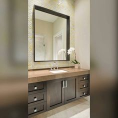 Loving This Renaissance Tile From Nicola Colclough.strong! It Gave This Modern Floating Vanity A Fun Sleek Look! Designer/ Christina Garcia  #dallasdesigngroup #ddginteriors #dallasdesign #interiordesigners #interiordesign #residentialdesign #socitile #tile #soci #vanity #bathdesign #bathroom #moderndesign #modern #sleek #bathroomdesign #countertop #backsplash #floatingvanity #cabinets #Regrann by istifada_kw