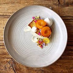 Orange poppyseed cake • Marjoram roasted apricots • Rose water mascarpone • pistachio & pumpkin seed • Candied lemon ...dish by @piersdawson #soignefood