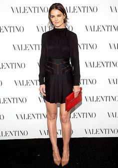 Katie Holmes sported a short LBD at the Valentino couture show in New York.