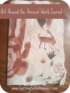 "We turned our ""cave painting"" into a homemade journal cover. 