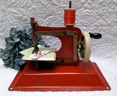 I want this now. Vintage Toy Sewing Machine