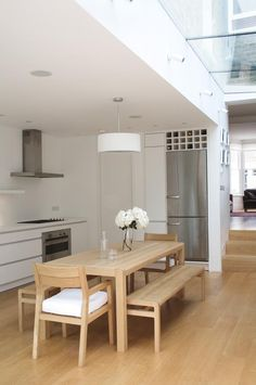 Remodelista-Hackett-Holland-Notting-Hill-kitchen-extension over counter recessed down lighting combined with pendant light