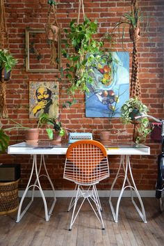 Workspace with plants and exposed brick