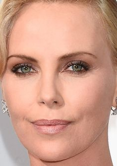 Close-up of Charlize Theron at the 2016 Oscars. http://beautyeditor.ca/2016/02/29/oscars-2016