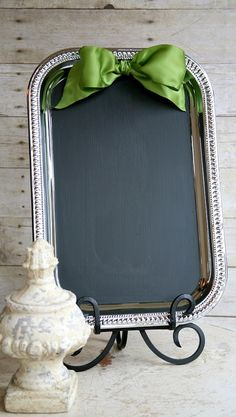 Dollar store trays + chalkboard spray paint = lovely way to display menus/do signage at our wedding...with navy blue bow