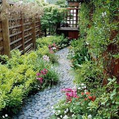 Run a Dry Stream - side yard idea. Keep water from collecting along your narrow side yard by forcing it out with a dry stream bed. Plus, it makes an attractive landscape feature in dry weather. Small Gardens, Outdoor Gardens, Garden Cottage, Garden Spaces, Small Space Gardening, Dream Garden, Garden Path, Pebble Garden, Lush Garden