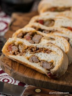 Sausage Bread - Warm crusty bread filled with a flavorful mixture of sweet Italian sausage, peppers and onions. This is delicious!