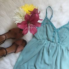 """Esley Sleeveless Hi Lo Dress in Seafoam S Beautiful and feminine! Draped front skirt from and empire waist. Embroidered strap detail. Pretty criss cross back. Straps are adjustable. 100% polyester. Hand wash recommended. As shown, 34"""" length in front. Esley Dresses Midi"""