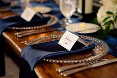 """Nothing says """"elegance"""" better than navy & gold place settings 