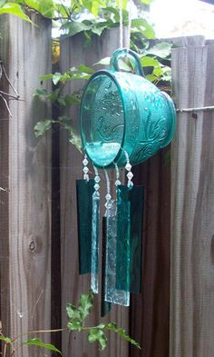 I find this a crying shame. all the depression glass this person wastes by drilling holes in it. use the cheap glass for wind chimes fool! not the really good stuff. Glass Wind Chimes, Diy Wind Chimes, Fused Glass, Stained Glass, Sun Catchers, Glass Tea Cups, Glass Garden, Mobiles, Yard Art