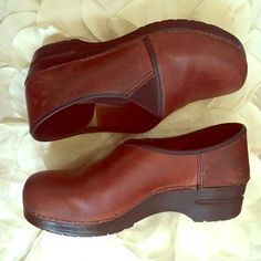 Brown Leather Dansko Clogs Comfy Brown Leather Dansko Clogs. Used a few times but still in good condition & have lots of life in them! Size Euro 40 but due to the wrap around design fits like a Size 9 Women's. Dansko Shoes Mules & Clogs