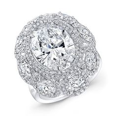 Diamond ring in 18k white gold with a 5.15 ct. oval-shape center stone with 2.5 cts. t.w. oval-shape diamonds and 0.87 ct. t.w. diamond melee.