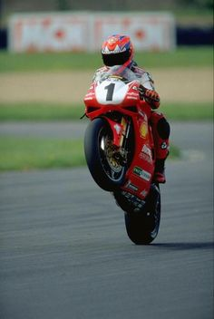 Carl Fogarty wheeling on the Ducati. SBK.